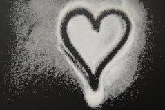 Spilled Sugar Heart Love Shape of Heart Black Background. unhealthy sugar. Love sugar Sweet. Spilled Sugar Heart Love Shape of Heart Black Background. unhealthy stock photo