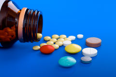 Spilled tablets and medicine bottle. stock photography