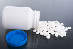 Spilled tablets (side). A lot of vitamin tablets are spilled on the tablet Stock Photography