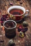 Spilled tea on wooden surface Stock Photo