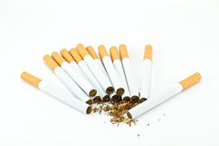 Spilled tobacco and cigarettes. Isolated on white Stock Photo
