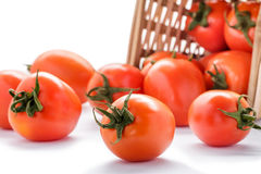 Spilled Tomatoes From Rattan Basket Stock Images