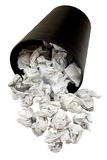 Spilled wastepaper basket full of crumpled paper. Isolated on white background royalty free stock photo