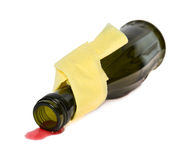 Spilled wine from a bottle on a white background Royalty Free Stock Photo