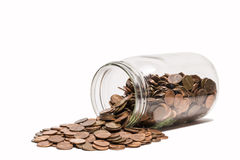 SpilledPenny Jar Royalty Free Stock Image
