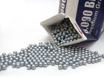 Spilling BB's. Silver BB's used in an air rifle Stock Photography