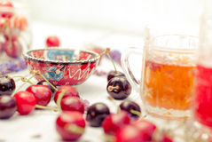 Spilling bright red cherries and drinks Royalty Free Stock Photo