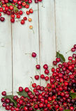 Spilling bright red cherries and drinks Stock Images