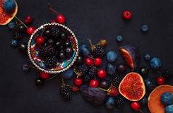 Spilling bright red cherries and drinks Royalty Free Stock Photography