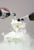 Spilling champagne in festive glasses. Stock Photos