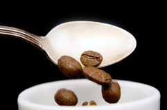 Spilling coffee beans Royalty Free Stock Photography
