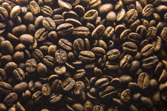 Spilling coffee beans Stock Images