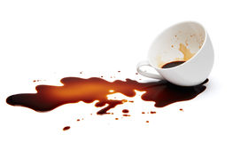 Spilling coffee. Cup of black coffee spilling causing stained Stock Images