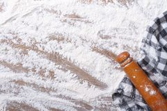Spilling flour, rolling pin and  towel close up background Stock Photo