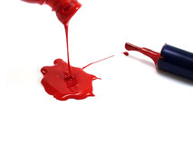Spilling paint and brush. Spilling red paint and brush isolated Royalty Free Stock Images