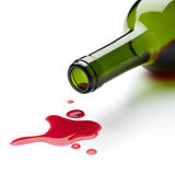 Spilling red wine. Red wine spilling from the bottle Royalty Free Stock Image
