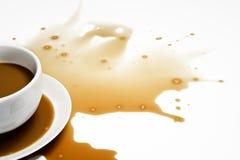 spillt kaffe Arkivbild