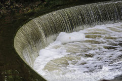Spillway at Hunt`s Mills. Water from Turner Reservoir spilling over small waterfall at Hunt`s Mills Royalty Free Stock Photo