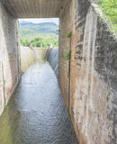 Spillway and the mountain Stock Image