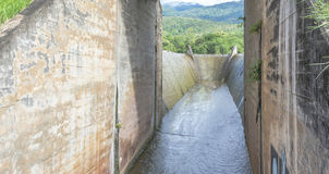 Spillway and the mountain Stock Photography