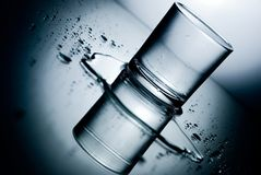 Spilt Drink. A glass of water on a table royalty free illustration