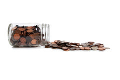 A Spilt jar of change on white Stock Photography