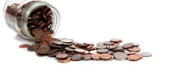 A Spilt jar of change on white Stock Images