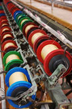 Spin. Colorful spin rollers working on a spinning machine Royalty Free Stock Image