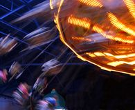 In a Spin. A Family are spun around at top speed in the Rafters of indoor Fun Fair royalty free stock image