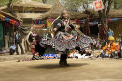 Spin. Female tribal dancer performing at the Sarujkund Fair near Delhi, India Royalty Free Stock Image