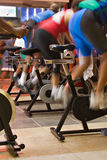 Spin the bike. Blur motion of group of people having a training session on spin bikes stock image