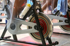 Spin the bike. Blur motion of people having a training session on spin bikes stock photos