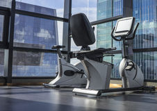 Spin Bike. Aerobics spinning exercise bikes gym room Royalty Free Stock Photography