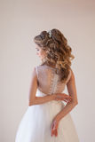 Spin the bride in a wedding dress in a white room Royalty Free Stock Image