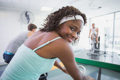 Spin class working out with motivational instructor Royalty Free Stock Image