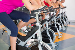 Spin class working out in a row Stock Images