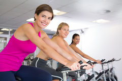 Spin class working out in a row Royalty Free Stock Image