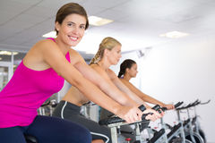 Spin class working out in a row Royalty Free Stock Photos