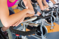 Spin class working out in a row Royalty Free Stock Images