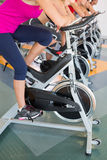 Spin class working out in a row Stock Photography
