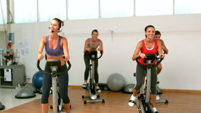 Spin class working out Stock Photos