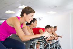 Spin class working out and smiling Royalty Free Stock Images