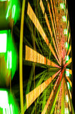 Spin of ferris wheel. Picture of fast-spinning ferris wheel with many lights stock images