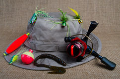 Spin Fishing for Bass. Fishing hat surrounded by bass fishing lures and bobbers Stock Photos
