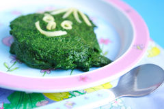 Spinach. Kid's dish - spinach Stock Image