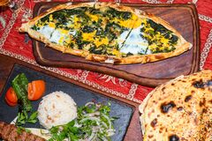 Free Spinach And Egg Pide, Pita Flat Bread And Puff Hot Lavash Or Lavas Homebaked Specialty Stock Images - 182213994