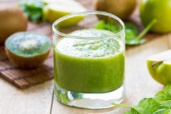 Spinach with Apple and Kiwi smoothie Stock Photos