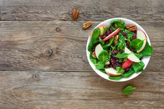 Spinach, apple salad with  pecan nuts and dry cranberries