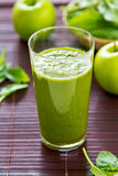 Spinach and apple smoothie stock photo