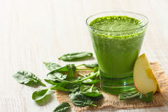 Spinach and apple smoothie. On a wooden table Stock Photography